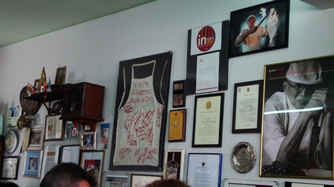 The dining rooms walls with their display of awards, articles, and memorabilia