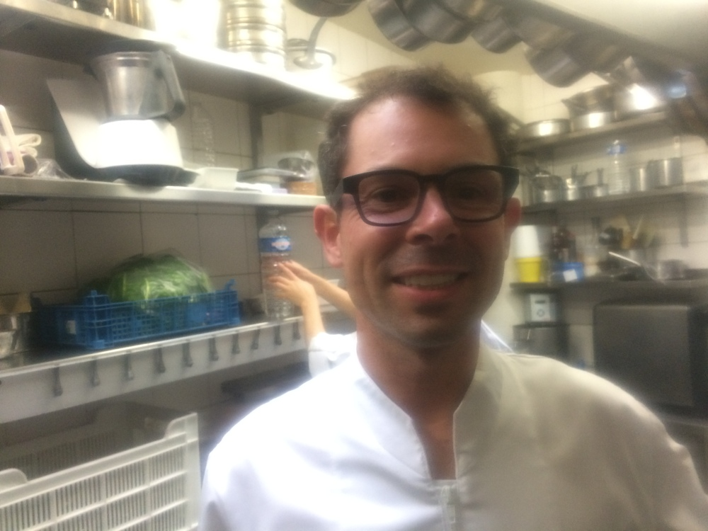 In his kitchen