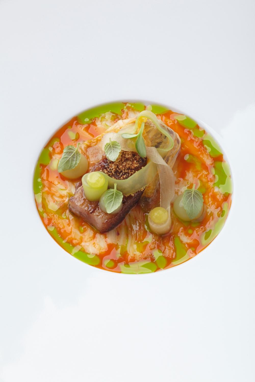 Pork chin and smoked eel with kimchi, fermented radish, cucumber, and yuzu