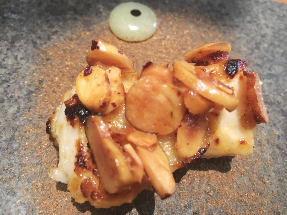 Gindara Misoyaki: Cod marinated in miso, crispy Bahuaja nuts, apple gel, Porcon mushrooms powder